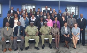 Participants, facilitators and other officials take a group photo after the RSS Crime Scene Training