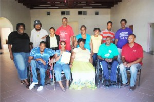 Class members pose for a group picture at the McKnight Community Centre. Mr Geoffrey Hanley is sitting on the right and next to him is Mr Anthony Mills.