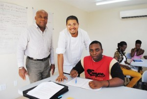The only male in the culinary arts class, Mr Tyrone Powell, gets all the attention: With him are PEP Training Coordinator for Nevis, Mr Hensley Daniel (left) and PEP Facilitator Mr Michael Henville