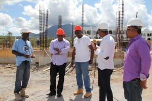 : Deputy Premier of Nevis and Minister of Tourism Hon. Mark Brantley (second from right) with the management team of the Residence at Tamarind Cove and Marina Project (L-R) Project Foreman Linel Amory, Project Manager Vaughn Walters and Assistant Project Manager Laughton Browne and Managing Director and local investor Greg Hardtman (extreme right)