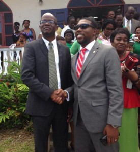 Hon. Patrice Nisbett shaking hands outside of church with St. Kitts- Nevis Attorney General, Hon. Jason Hamilton