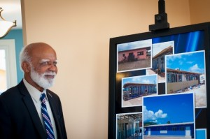 Governor General His Excellency Sir Edmund Lawrence reviews a photo display of the transformation of the building