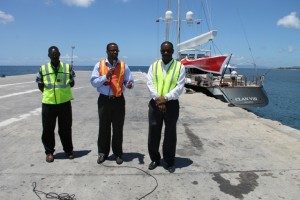 (l-r) Supervisor of Security at the Nevis Air and Sea Ports Authority (NASPA) Simeon Prentice , Deputy Premier and Minister of Tourism in the Nevis Island Administration Hon. Mark Brantley and Chairman of NASPA Colin Dore at the Long Point Pier with Super Yacht CLAN VIII Valletta on April 03, 2014