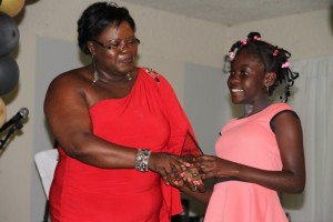 Ms. Husaene Martin accepting the Hazel Brandy-Williams Award for selflessness and team spirit from Junior Minister for Youth and Sports in the Nevis Island Administration Hon. Hazel Brandy-Williams at the Department of Youth and Sports Awards Ceremony and Gala on April 26, 2014 at the Occasions Conference Centre at the Pinney's Industrial Site