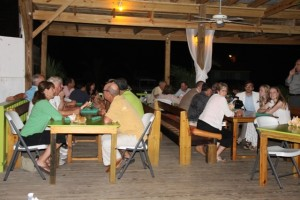 section of persons at a cocktail reception at the Lime Beach Bar and Grill at Pinneys Beach Bar and Grill at Pinneys Beach, hosted by the Nevis Tourism Authority and the Nevis Air and Sea Ports Authority