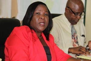 Permanent Secretary in the Ministry of Education Mrs. Lornette Queeley-Connor with Cabinet Secretary Steadmond Tross in the background
