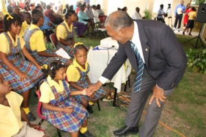 Premier of Nevis and Minister of Education greets students of the Special Education Unit at Prospect during a ceremony to rename the school in honour of its first supervisor Cecele Browne on April 29, 2014