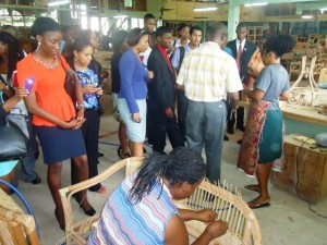 Caricom Youth Ambassadors observing work being done at the Liana Cane Interiors Ltd Company