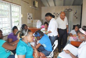 Colours of Success: Cosmetology trainees in Nevis during a colouring session. Looking on are Facilitator, Ms Krista Chapman, and PEP Training Coordinator for Nevis Mr Hensley Daniel.
