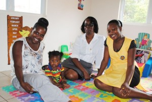 Mrs Patricia Dasent (centre) recently played host to Canada-based Kittitian Early Childhood practitioner Mrs Donna Blake and her eight-month son Treval Blake-Bassue who were in the Federation for a visit. With them is PEP Early Childhood Caregiver trainee, Ms Victoria Newton