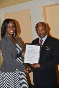 St. Kitts and Nevis' Prime Minister the Rt. Hon. Dr. Denzil L. Douglas (right) presents certificate to Ms. Hadassah Willett of Nevis to study medicine.