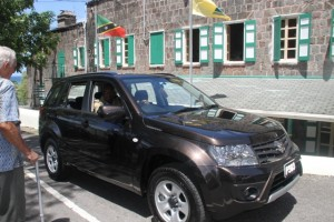 Assistant Commissioner of Police Robert Liburd in the new Suzuki Grand Vitara, donated to the people of Nevis by retired businessman Charles Brisbane on September 18, 2014