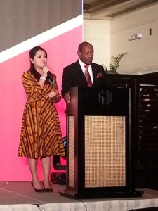 St. Kitts and Nevis' Prime Minister the Rt. Hon. Dr. Denzil L. Douglas (right) addressing a group of business people in Hanoi with the assistance of an interpreter.