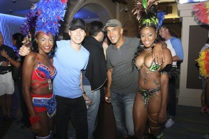 Models in Sugar Mas costumes welcome the pokers players to St. Kitts b