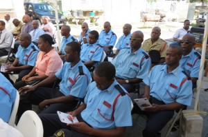Officers of the St. Kitts-Nevis Fire and Rescue Services Nevis Division at the handing over ceremony of a new fire tender funded by the European Development Fund and the federal Government on December 17, 2014