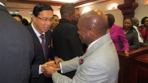 Resident Ambassador of the Republic of China (Taiwan) His Excellency Miguel Tsao (left) congratulating St. Kitts and Nevis' Prime Minister and Minister of Finance the Rt. Hon. Dr. Denzil L. Douglas on the presentation of the 2015 Budget Address