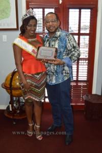 The 2014/2015 Miss Caribbean Culture Queen, Yarayni Morton presents plaque to businessman Mr. Gregory 'Greg' Hardtman