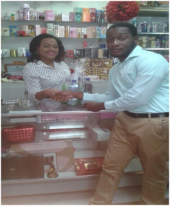 Representative from SEN Consulting with Mrs. Monica Pemberton , Cell Phone Top Up Sales Agent