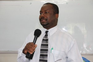Permanent Secretary in the Ministry of Social Development Keith Glasgow at the launch of the Introduction to Computer Classes for Seniors at the Nevis International School's computer lab on January 29, 2015