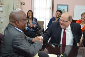 PM Harris and Ambassador Herrera shake on agreement