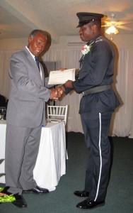 Premier Amory presents award to PC Charles