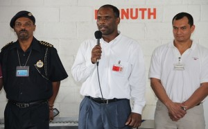 Deputy Comptroller of Customs Cynric Carey, Permanent Secretary in the Ministry of Finance in the Nevis Island Administration Colin Dore and Co-Founder of Security Equipment Services and Representative for Autoclear, the manufacturer of the X-ray system Salvador Leanos at the X-ray inspection system Handing Over Ceremony on March 13, 2015, at the Long Point Por