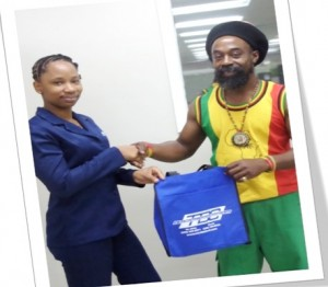 Mr. Craig Charles, St. Kitts' winner in the TDC Pick Your Deal Promotion being presented by Ms. Shantell Pemberton, Hire Purchase Clerk at TDC Home and Building Depot (St. Kitts)