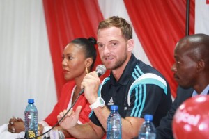 David Monk speaks to media at the opening press conference for the start of the Digicel Kickstart Clinics in Haiti