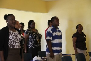 Some of the participants sing the national anthem during the opening ceremony of a Caribbean Development Bank Management sponsored Accounting Systems for MSMEs eight-day workshop on April 13, 2015 at the Ministry of Education's Conference Room