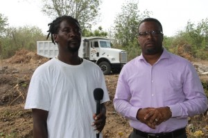 L-R) Managing Director of DC Equipment and Stoney Grove resident Dale Claxton and Deputy Premier of Nevis Hon Mark Brantley on site at the Upper Stoney Grove ghaut on Friday 8th May, 2015