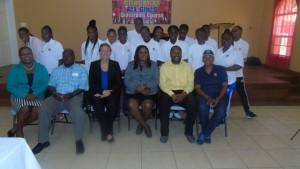 Trainers and trainees pose with officials