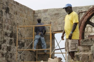 Local Contractor Myron Weston Jeffers oversees his team at the start of construction works on the roof of the the sugar mill at New River Estate on June 09, 2015