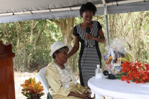 "Reverend Careen White-Richardson presenting Albertine ""Dovie"" Elliott with a gift basket during her birthday celebration on July 10, 2015, at Valley, New River"