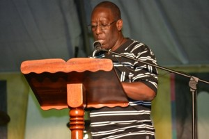 Executive Director of the Culturama Secretariat Abonaty Liburd reading profiles of the patron at the opening ceremony of Culturama 2015 at the Charlestown Waterfront on July 23, 2015