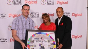 John Delves, Regional CEO (left) receives a token on behalf of Denis O'Brien from Special Olympics Jamaica Chairperson, Lorna Bell and Patron Aldrick McNabb
