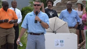 Executive Director of the Sea Turtle Conservancy David Godfrey at the release of sea turtle Millie on the beach outside the Four Seasons Resort on Nevis on July 13, 2015. Director of Recreation at the Four Seasons Resort Mackie France who chaired the event stands on his extreme left while Permanent Secretary in the Ministry of Agriculture and Fisheries Eric Evelyn who spoke on behalf of Hon. Alexis Jeffers stands second from left