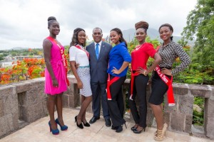 Premier of Nevis Hon. Vance Amory (middle) with Miss Culture Swimwear (l-r) Kenesha Jones, Shirnaldeen Lewis, Karimah Lake, Raven Richards and Shanika Joshua on the terrace on the top floor of the Nevis Island Administration on July 13, 2015
