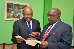 Willett Photo Studio 3: PM Harris and His Excellency share a private moment following the Swearing In --