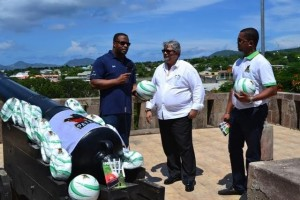 Deputy Premier of Nevis Hon. Mark Brantley (left) accepts donation from St. Kitts and Nevis Patriots executive.