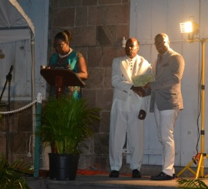 Minister of Social Development on Nevis Hon. Mark Brantley presents honouree Frank Mills of the St. James Parish with a certificate of appreciation, at the annual Charlestown Christmas Tree lighting Ceremony on December 02, 2015, for his outstanding contribution to the community
