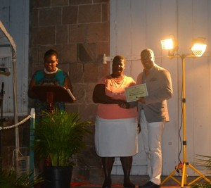 Minister of Social Development on Nevis Hon. Mark Brantley presents honouree Jacqueline Wallace of the St. Johns Parish with a certificate of appreciation, at the annual Charlestown Christmas Tree lighting Ceremony on December 02, 2015, for his outstanding contribution to the community Marjorie Brandy of St. Georges Parish, honoured for outstanding contribution to community development