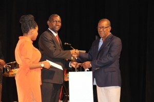 Errol Pemberton is awarded by the Ministry of Tourism on Nevis for his 35 years of photography service to Nevis at the awards ceremony for the Annual Photographer of the Year Competition 2016 at the Awards Ceremony at the Nevis Performing Arts Centre on March 18, 2016