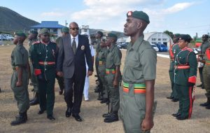 Governor General His Excellency, Sir S. W. Tapley Seaton inspects the guard