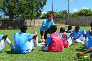 The coaches from Manchester City FC sharing valuable insights with the Anguilla boys on how to improve their game at the Digicel Kickstart Clinic