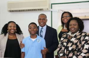 (l-r) Letisha Dore and her son Jayden Dore, Premier of Nevis Hon. Vance Amory, Coordinator of Youth Development Zahnela Claxton and Junior Minister of Youth and Sports Hon. Hazel Brandy-Williams at Mr. Amory's office at Bath Hotel on April 19, 2016,