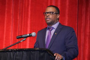 Deputy Premier of Nevis and Minister of Tourism in the Nevis Island Administration Hon. Mark Brantley, delivering welcome remarks at the 2016 Bank of Nevis Ltd. Tourism Youth Congress on May 19, 2016 at the Nevis Performing Arts Centre